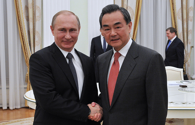 Russian President Vladimir Putin and Chinese Foreign Minister Wang Yi