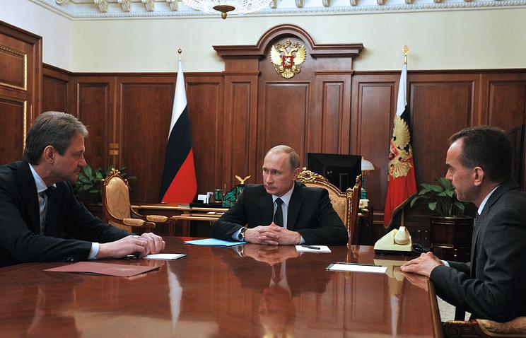 Alexander Tkachev, the governor of the Krasnodar region (left) and Russia's President Vladimir Putin (center)
