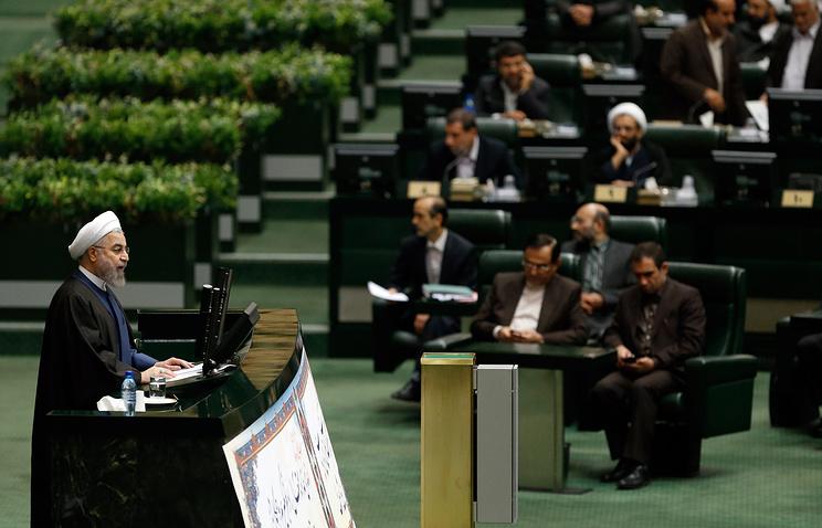 Iranian President Hassan Rouhani (left)
