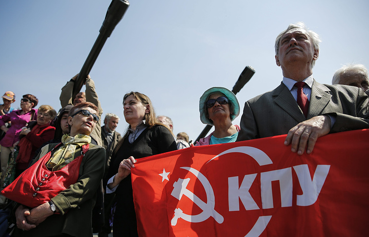 Supporters of the Ukrainian Communist Party attend a rally on May 1