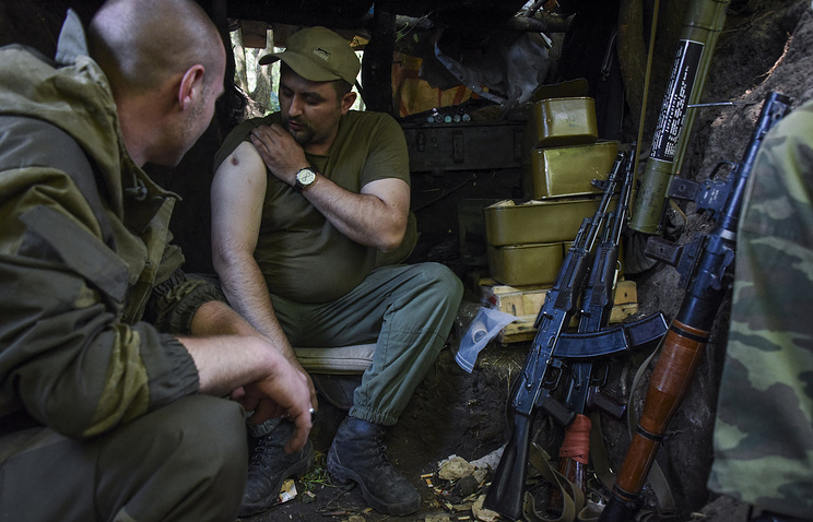 A Donbas militia fighter shows a scar from a gunshot wound