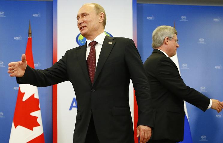 Russian President Vladimir Putin and Canadian Prime Minister Stephen Harper