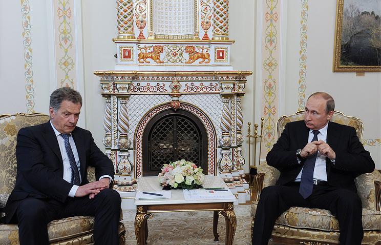 The presidents of Russia and Finland, Vladimir Putin (right) and Sauli Niinisto