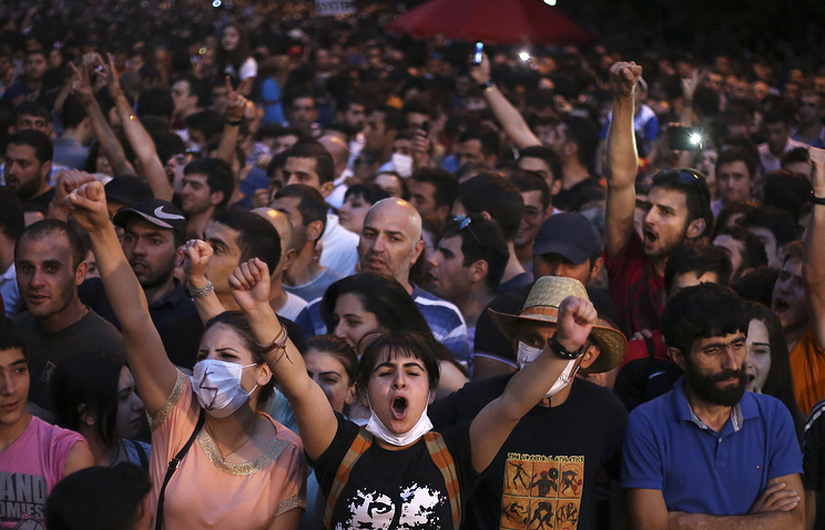 Armenian protesters during a rally against a hike in electricity prices in Yerevan