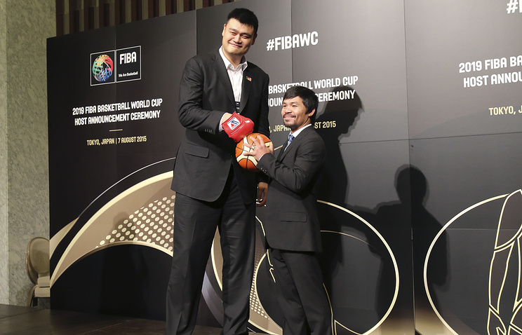 Former basketball star Yao Ming and Philippine eight-time world boxing champion Manny Pacquiao at FIBA's announcement on 2019 Basketball World Cup host