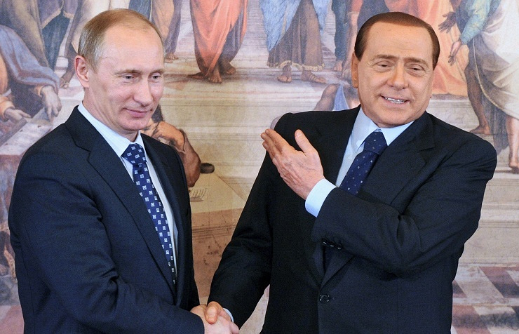 Vladimir Putin (left) and Silvio Berlusconi (right)