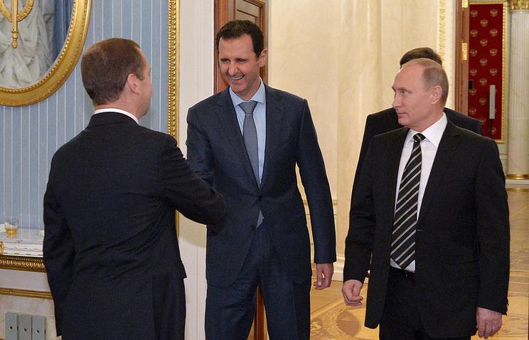 Russia's Prime Minister Dmitry Medvedev, Syria's President Bashar al-Assad and Russia's President Vladimir Putin