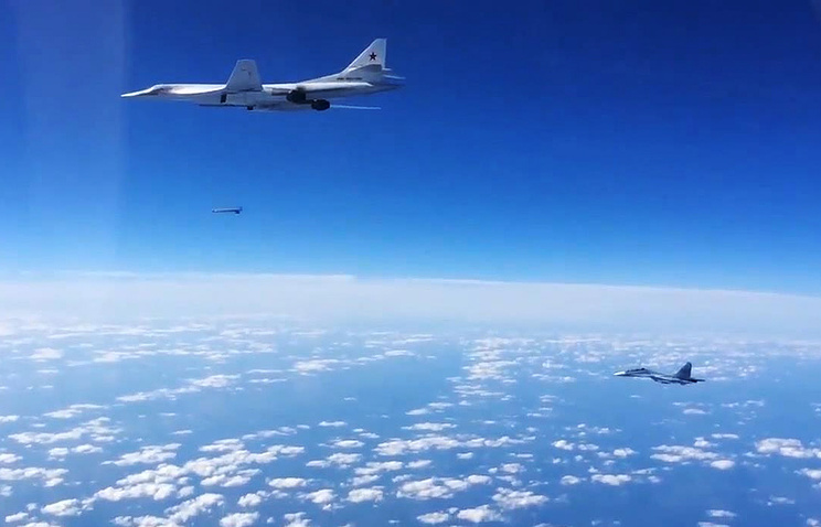 Russian SU-30SM fighter jet escorts a Tupolev Tu-160 strategic bomber during airstrikes against IS targets in Syria
