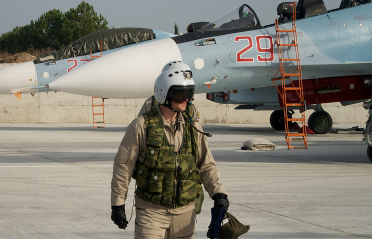 Russian pilot walking from his Su-30 jet at an airbase in Syria