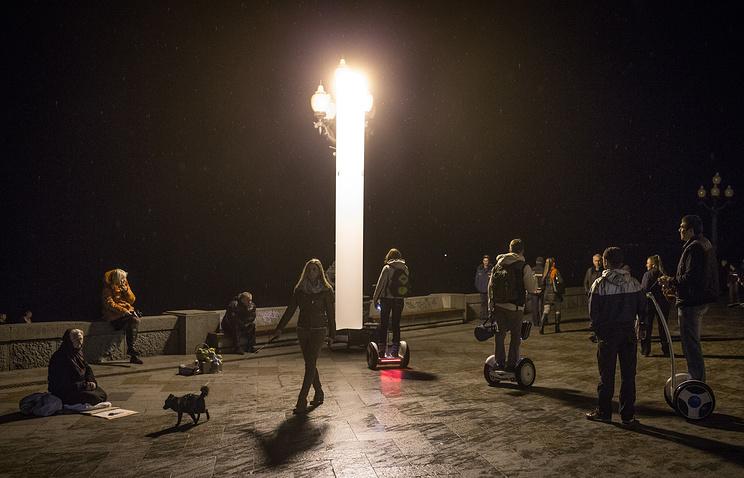 Yalta residents walking by the Black Sea, Crimea