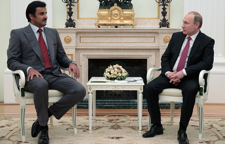 Emir of Qatar Tamim bin Hamad al Thani (left) and Russian President Vladimir Putin
