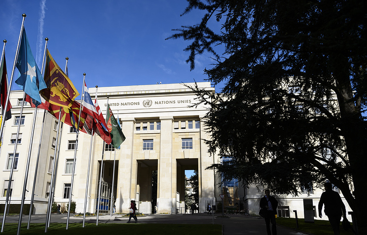 Flags in front of the Palais des Nations during Syria peace talks, Switzerland, 02 February