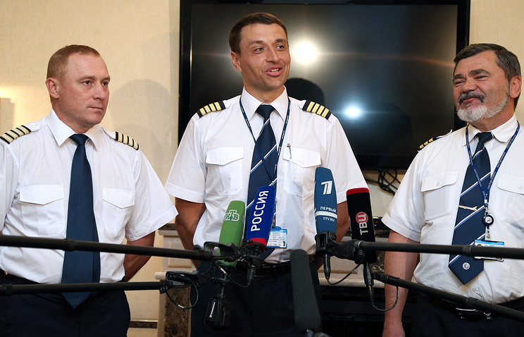 Co-pilot Andrei Kartashov, first pilot Konstantin Parikozha and co-pilot Dmitry Alkeyev