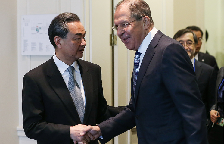 hinese Foreign Minister Wang Yi and Russian Foreign Minister Sergey Lavrov