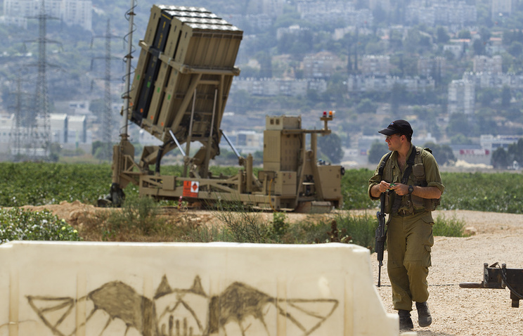 An Israeli soldier guards an air force Iron Dome missile intercepter unit