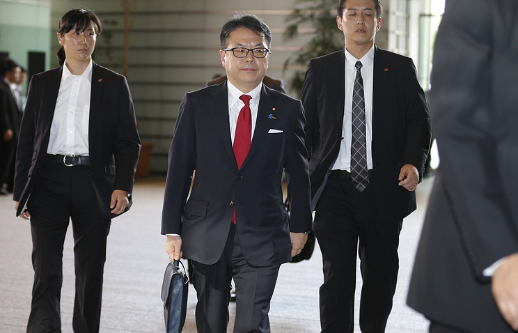Japan's Economy, Trade and Industry Minister Hiroshige Seko (center)