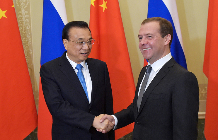 China's Premier of the State Council Li Keqiang and Russian Prime Minister Dmitry Medvedev
