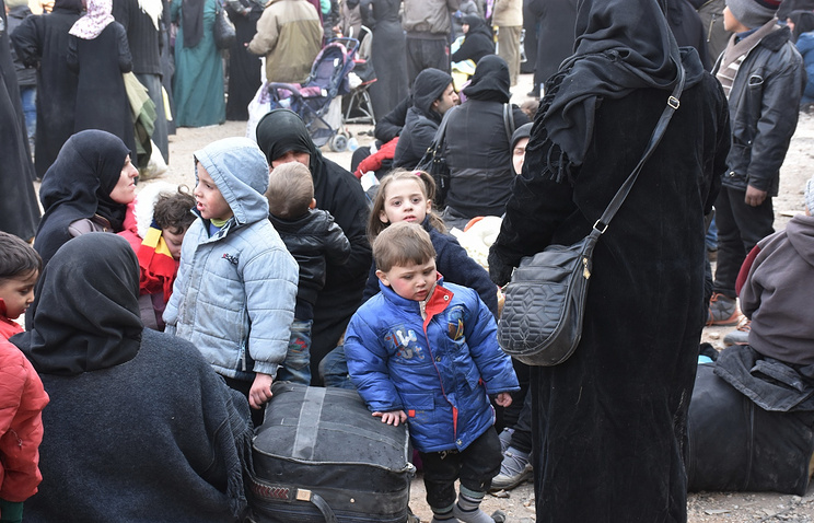 Syrians in eastern neighborhoods of Aleppo