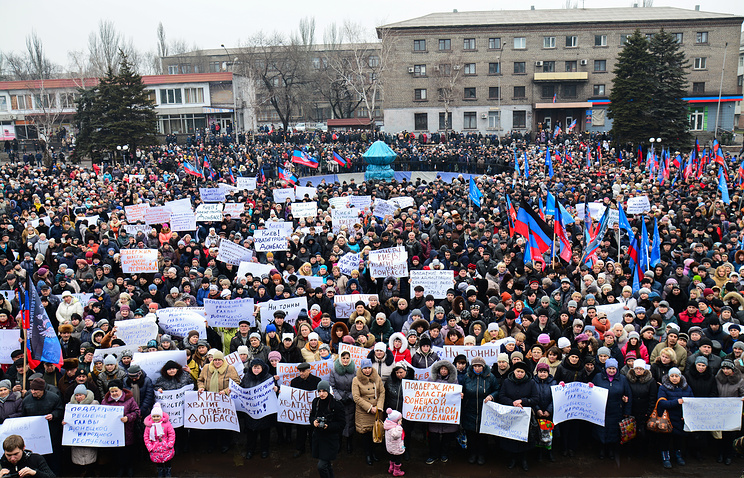 People take part in a rally against a rail blockade of Donbass in Donetsk region
