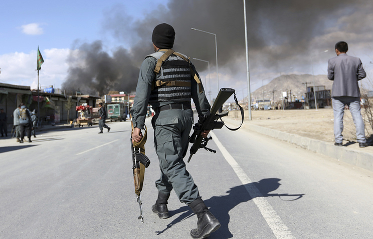 Afghan security forces seen after a suicide attack claimed by the Taliban in Kabul, Afghanistan