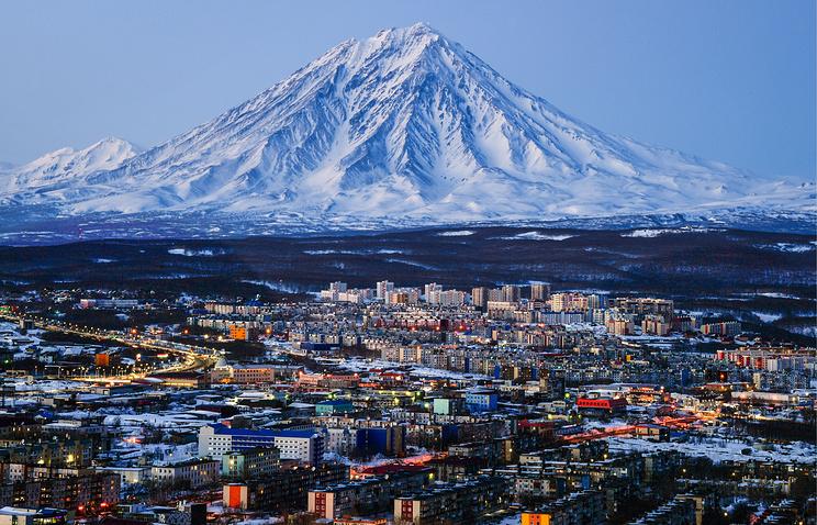 Koryaksky volcano over the town of Petropavlovsk-Kamchatsky in the Kamchatka region of Far-Eastern Russia