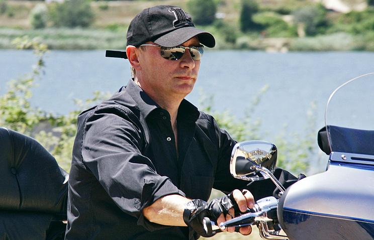 Russian President Vladimir Putin riding a Harley Davidson trike, 2010