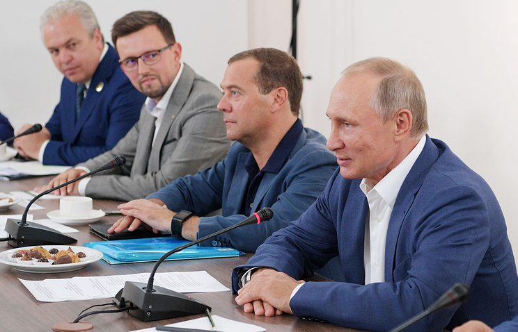 Russia's Prime Minister Dmitry Medvedev (2nd R) and Russia's President Vladimir Putin (R)