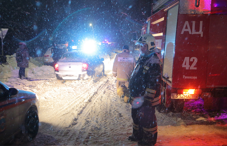 Russian fire fighters at the site of plane crash near Argunovo, Moscow region