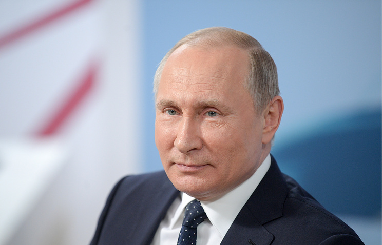 Vladimir Putin tells the West that he doesn't want an arms race