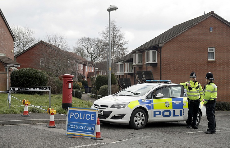 Police officers stand guard near the house of Sergei Skripal in Salisbury, England