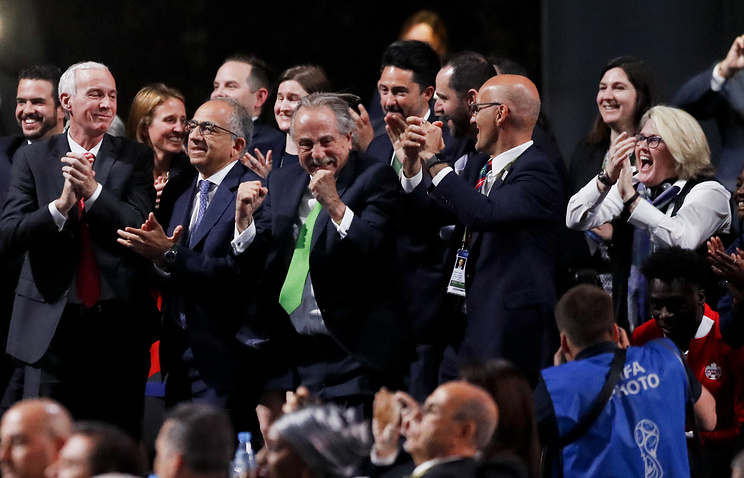 Delegates of Canada, Mexico and the United States celebrate after winning a joint bid to host the 2026 World Cup at the FIFA congress in Moscow