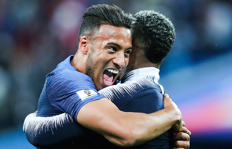 France's Corentin Tolisso (L) and Benjamin Mendy celebrate victory in the 2018 FIFA World Cup Semi-final match between France and Belgium at Saint Petersburg Stadium