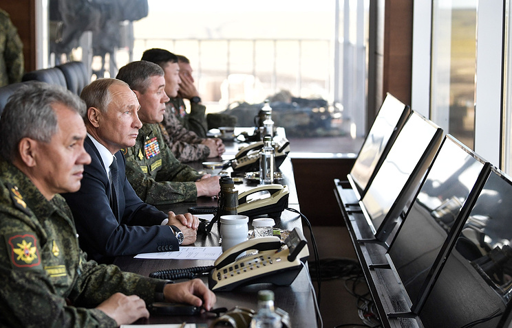 Russian President Vladimir Putin observing the main stage of the Vostok 2018 military exercises