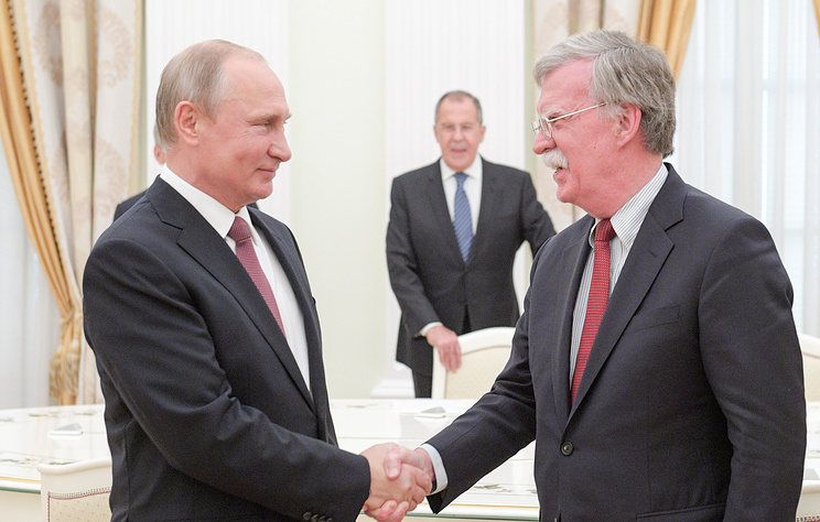Russian President Vladimir Putin and US National Security Advisor John Bolton