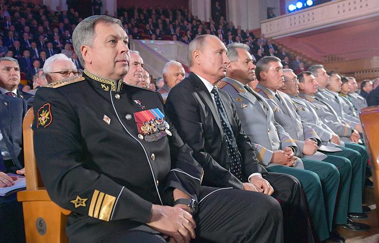 Vice-Admiral Igor Kostyukov, Russia's President Vladimir Putin, Russia's Defense Minister Sergei Shoigu and Russia's Deputy Defense Minister Valery Gerasimov