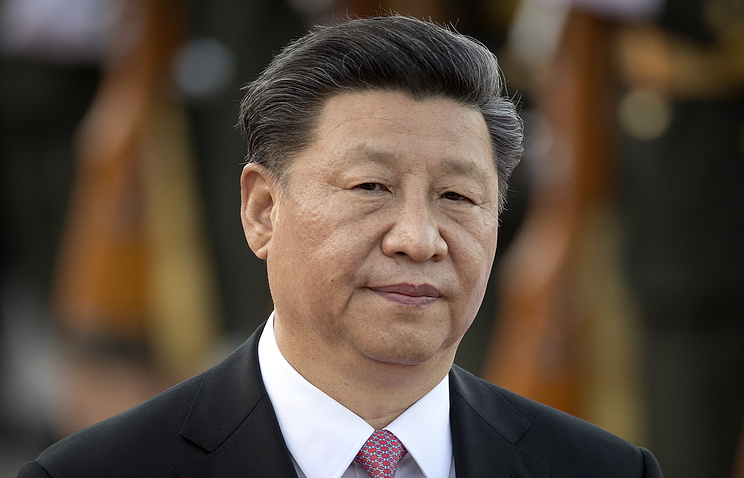 Amid trade war, China's Xi talks up economy