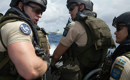 Swedish EMF (Embarked Military Force) commandos from the EUNAVFOR flagship Swedish warship. AP Photo/Tim Freccia