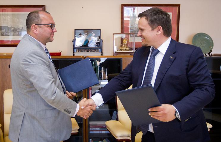 Генеральный директор ИТАР-ТАСС Сергей Михайлов и генеральный директор АСИ Андрей Никитин