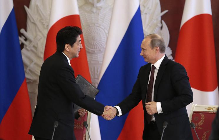 Синдзо Абэ и Владимир Путин. 2013 год