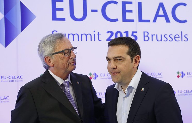 Президент Европейской комиссии Жан-Клод Юнкер (слева) и премьер-министр Греции Алексис Ципрас