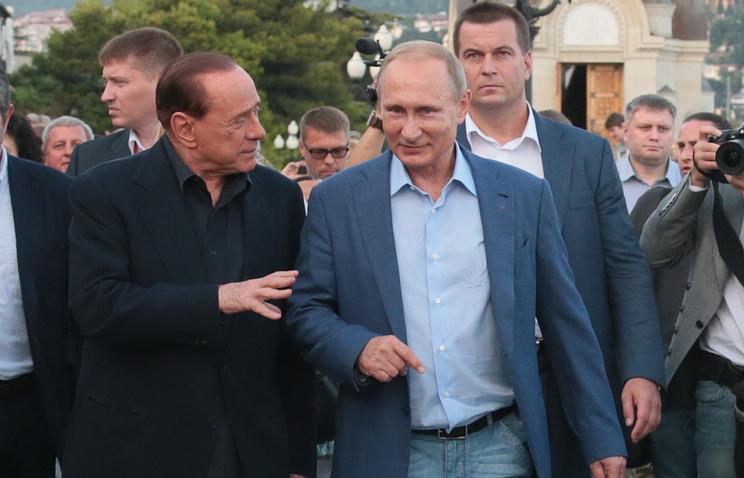 Бывший премьер-министр Италии Сильвио Берлускони и президент РФ Владимир Путин