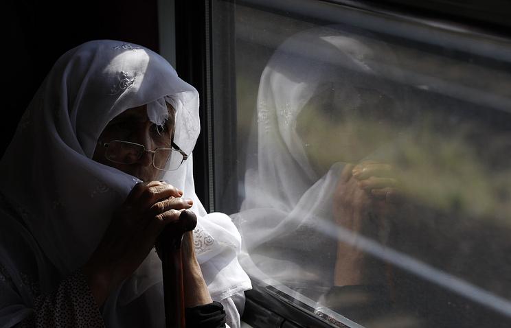 """Женщина в поезде, покинувшим вокзал """"Келети"""" в Будапеште, Венгрия, 3 сентября 2015 года. Архив"""