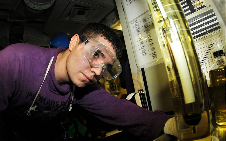 Aviation Boatswain's Mate (Fuels) 3rd Class Joshua Palomares checks the specific gravity of biofuel with a thermo hydrometer in the quality surveillance fuel shop aboard the aircraft carrier USS Nimitz (CVN 68) during a replenishment at sea. Nimitz took on 200,000 gallons of a 50-50 blend of advanced biofuels and traditional petroleum based fuel during the U.S. Navy's Great Green Fleet demonstration portion of the Rim of the Pacific (RIMPAC) 2012 exercise. (U.S. Navy photo by Mass Communication Specialist 3rd Class Devin Wray/Released)