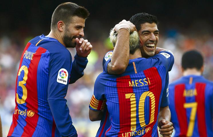 """Футболисты """"Барселоны"""" после очередного гола в ворота """"Бетиса"""""""