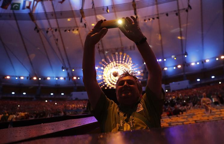 Болельщик во время церемонии закрытия Олимпийских игр в Рио-де-Жанейро