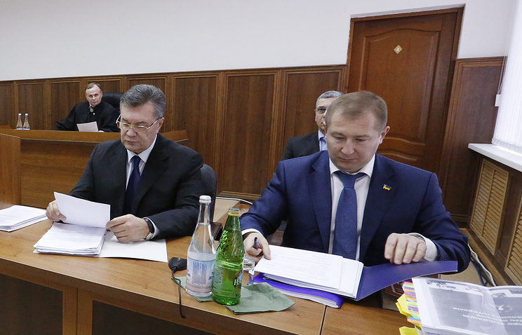 Бывший президент Украины Виктор Янукович и адвокат Виталий Сердюк