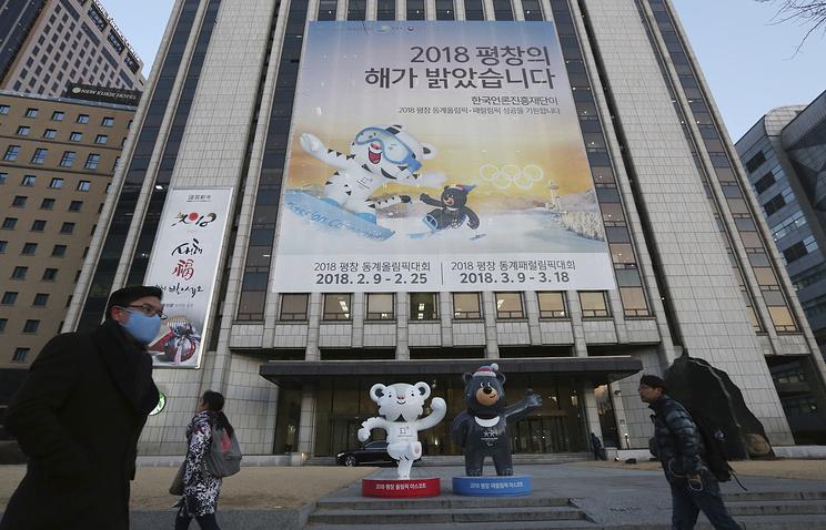 Баннер с изображением олимпийских маскотов в Сеуле