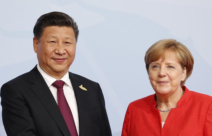 Председатель КНР Си Цзиньпин и канцлер ФРГ Ангела Меркель