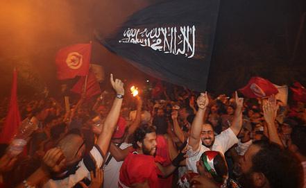 """Акция в поддержку исламистской партии """"Ан-Нахда"""". Фото EPA/ИТАР-ТАСС"""