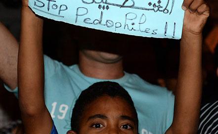 Акция против помилования испанского педофила в Марокко. Фото EPA/ИТАР-ТАСС